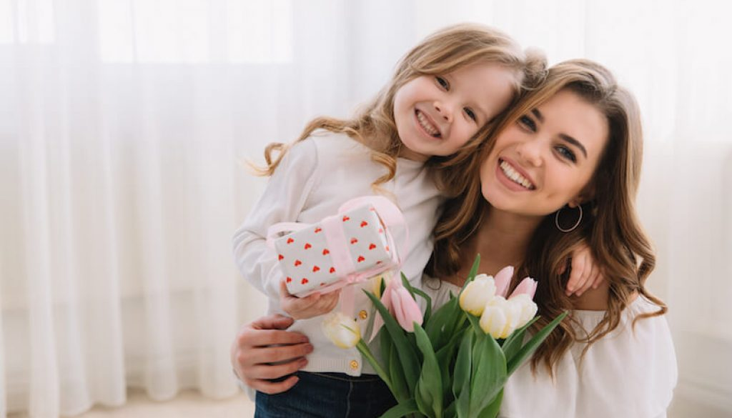 happy-mother-s-day-child-daughter-congratulates-moms-gives-her-flowers-tulips-gift (1)